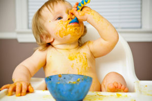 messy-baby-eating-a-meal_j4xbj6